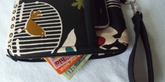 Wristlet wallet with phone, money and credit cards